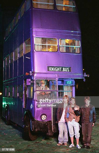 Actor Rupert Grint Actress Emma Watson and Daniel Radcliffe pose in front of the magical purple Knight bus during the Harry Potter And The Prisoner...