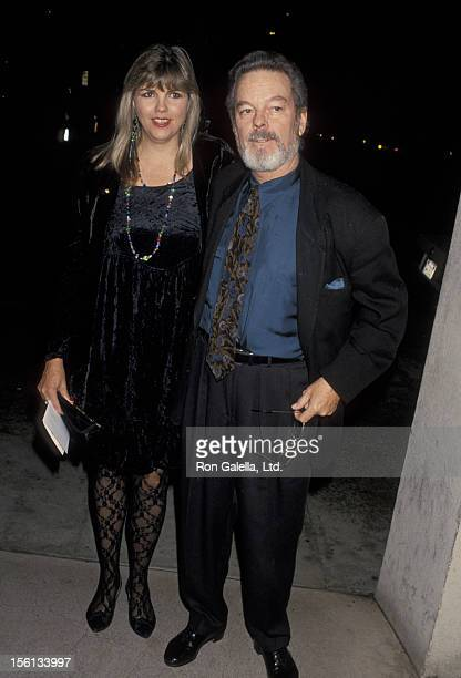 Actor Russ Tamblyn and wife Bonnie Murray attending 'PreHoliday Party Hosted by Norby Walter' on November 22 1993 at Club Tatou in Beverly Hills...