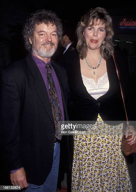 Actor Russ Tamblyn and wife Bonnie Murray attending the opening of 'Favor Watch Big Fish' on May 7 1992 at the Beverly Theater in Beverly Hills...