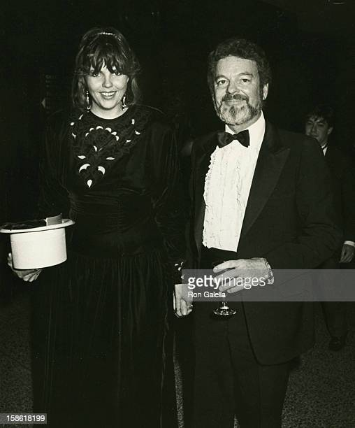 Actor Russ Tamblyn and wife Bonnie Murray attending the premiere of That's Dancing on January 14 1985 at the New York Hilton Hotel in New York City...