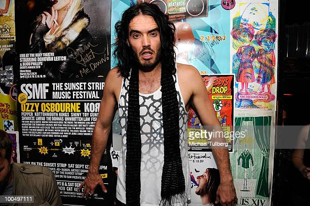 Actor Russell Brand poses backstage after a concert with the band Infant Sorrow to promote the new film 'Get Him To The Greek' at the Roxy Theatre on...