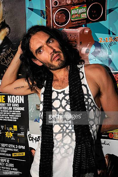 Actor Russell Brand poses backstage following a concert with the band Infant Sorrow to promote the new film 'Get Him To The Greek' at the Roxy...