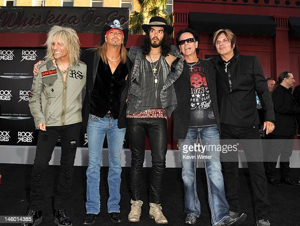 Actor Russell Brand with musicians CC DeVille Bret Michaels Bobby Dall and Rikki Rockett of Poison arrive at the premiere of Warner Bros Pictures'...