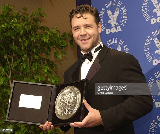 Actor Russell Crowe accepting the nominee's plate for Outstanding Directorial Achievement in Feature Film on behalf of director Ridley Scott and his...