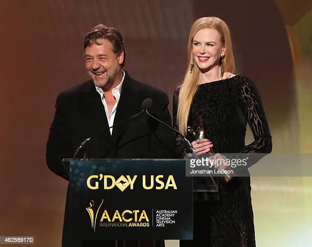 Actor Russell Crowe accepts an award from host Nicole Kidman onstage during the 2015 G'Day USA GALA featuring the AACTA International Awards...