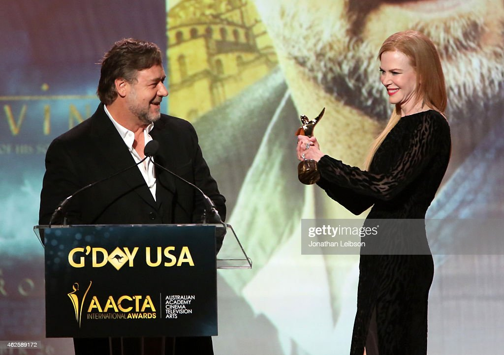 Actor Russell Crowe accepts an award from host Nicole Kidman onstage during the 2015 G'Day USA GALA featuring the AACTA International Awards presented by QANTAS at Hollywood Palladium on January 31, 2015 in Los Angeles, California.