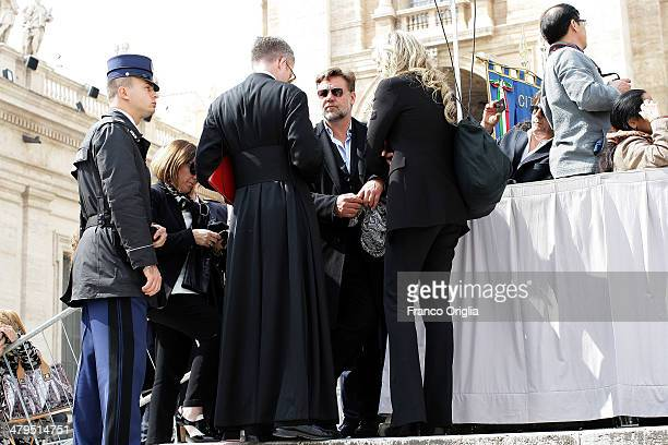 Actor Russell Crowe and Tiziana Rocca attend Pope Francis' weekly audience in St Peter's Square on March 19 2014 in Vatican City Vatican Speaking to...
