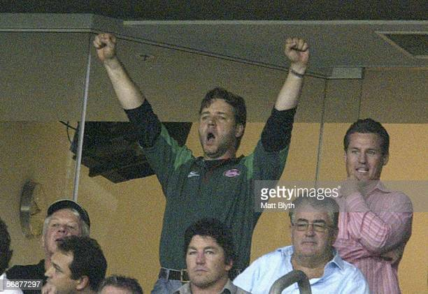 Actor Russell Crowe celebrates after the Rabbitohs 14-12 win over the Dragons during the NRL Charity Shield match between the South Sydney Rabbitohs...