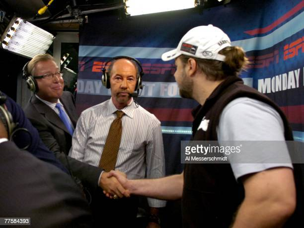 Actor Russell Crowe meets ESPN analysts Ron Jaworski and Tony Kornheiser as the Jacksonville Jaguars host the Indianapolis Colts at the Jacksonville...