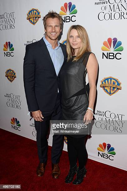 Actor Rusty Joiner and actress Charity Walden arrives at the premiere of Warner Bros Television's Dolly Parton's Coat of Many Colors at the Egyptian...