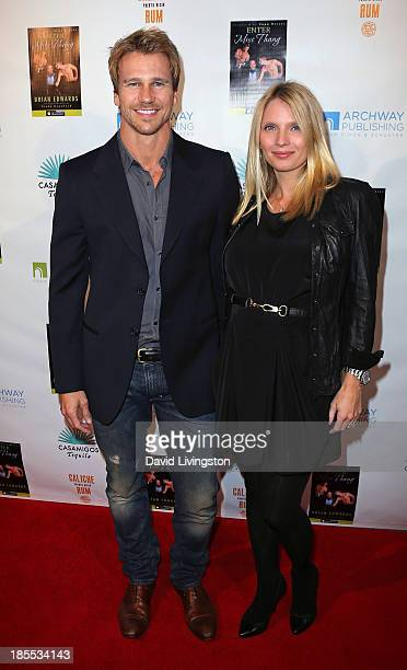 Actor Rusty Joiner and wife Charity Walden attend the launch party for Brian Edwards' book Enter Miss Thang at Cafe Habana on October 21 2013 in...