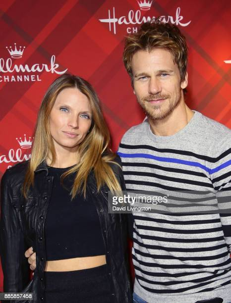 Actor Rusty Joiner and wife Charity Walden Joiner attend a screening of Hallmark Channel's Christmas at Holly Lodge at The Grove on December 4 2017...