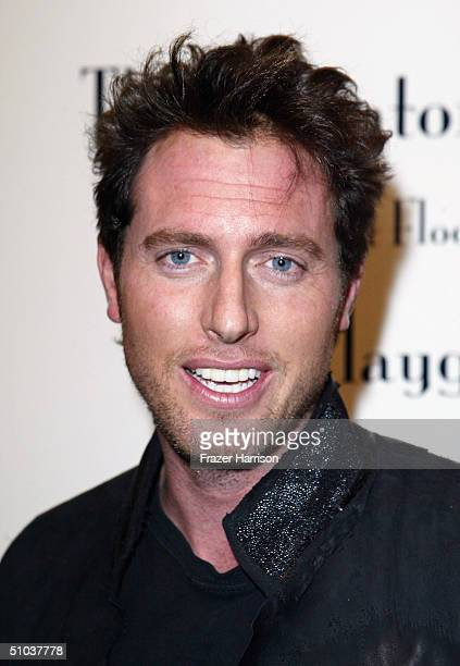 Actor Ryan Alosio poses at the Heike Jarick Fashion Show presented by Blackbook Magazine at The Elevator Gallery on July 8 2004 Venice California