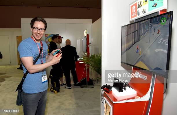 Actor Ryan Cartwright plays Super Mario Odyssey at the Nintendo booth at the 2017 E3 Gaming Convention at Los Angeles Convention Center on June 15...