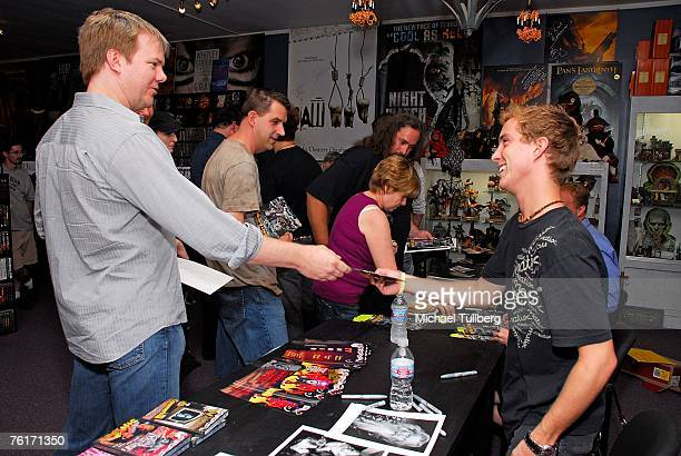 Actor Ryan Fleming talks witha fan at an autograph party for the new graphic novel '2001 Maniacs' held at the Dark Delicacies bookstore on August 18...