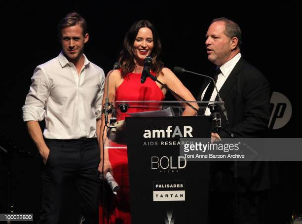 Actor Ryan Gosling actress Emily Blunt and producer Harvey Weinstein speak during amfAR's Cinema Against AIDS 2010 benefit gala at the Hotel du Cap...