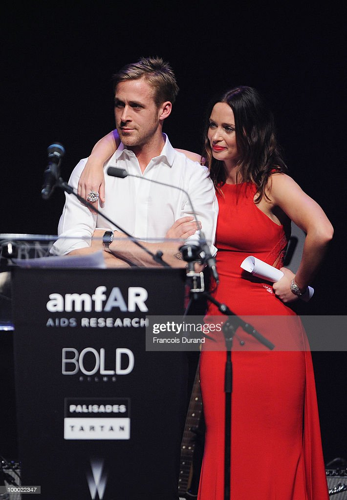 Actor Ryan Gosling (L) and acterss Emily Blunt speak during amfAR's Cinema Against AIDS 2010 benefit gala at the Hotel du Cap on May 20, 2010 in Antibes, France.