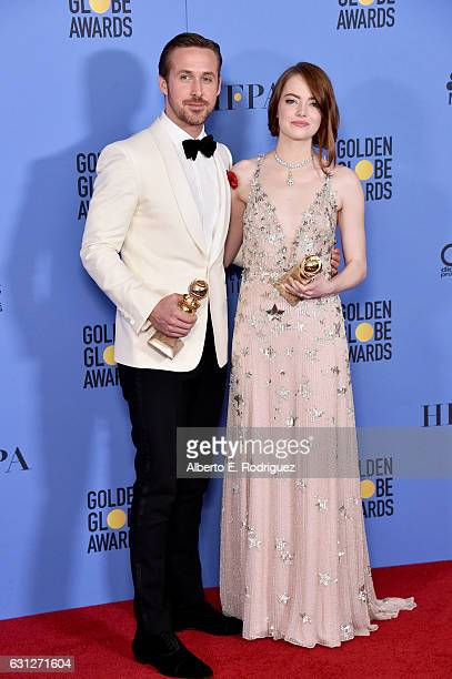 Actor Ryan Gosling and actress Emma Stone pose in the press room during the 74th Annual Golden Globe Awards at The Beverly Hilton Hotel on January 8...