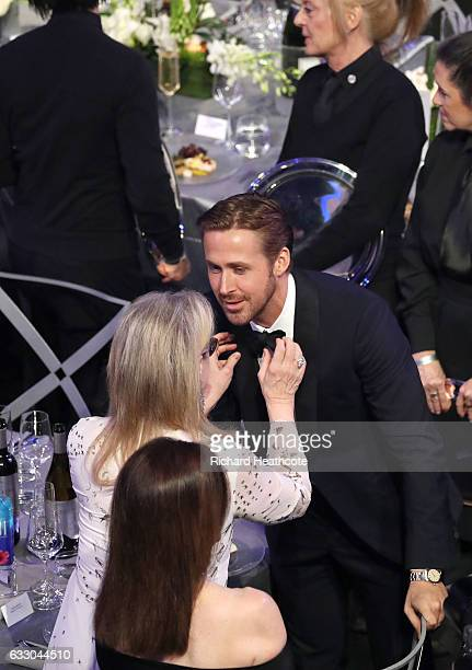 Actor Ryan Gosling has his tie adjusted by Meryl Streep during The 23rd Annual Screen Actors Guild Awards at The Shrine Auditorium on January 29 2017...