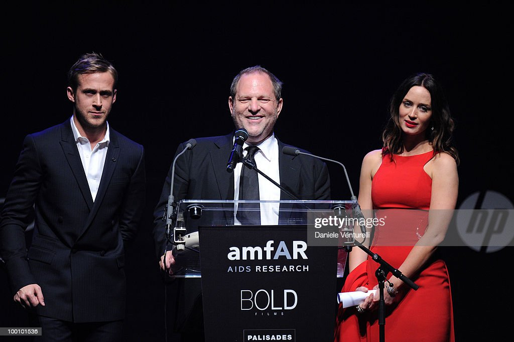 Actor Ryan Gosling, producer Harvey Weinstein and actress Emily Blunt speak during amfAR's Cinema Against AIDS 2010 benefit gala at the Hotel du Cap on May 20, 2010 in Antibes, France.