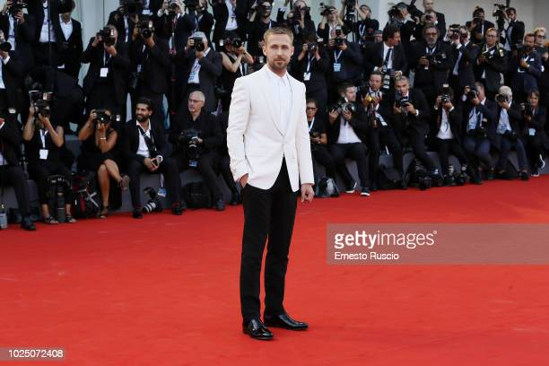 Actor Ryan Gosling walks the red carpet ahead of the opening ceremony and the 'First Man' screening during the 75th Venice Film Festival at Sala...