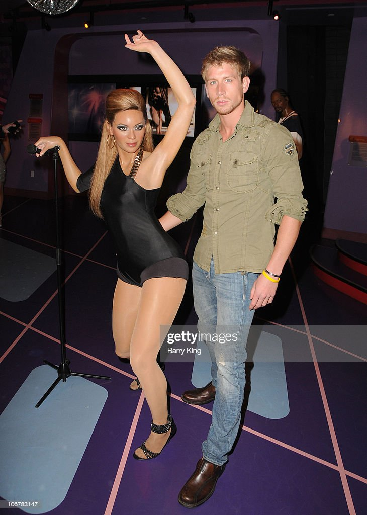 Actor Ryan McIntyre with Beyonce figure at the Official Los Angeles Event Celebrating Harvey Milk Day at Madame Tussaud's Hollywood on May 22, 2010 in Hollywood, California.