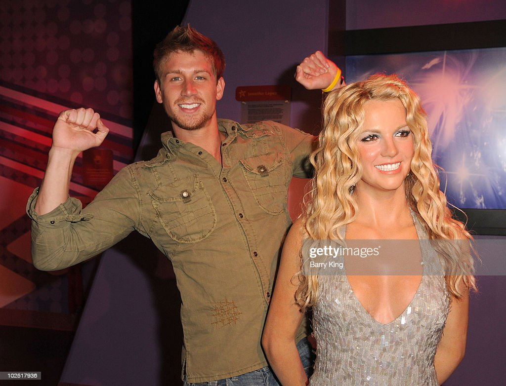 Actor Ryan McIntyre with Britney Spears figure at the Official Los Angeles Event Celebrating Harvey Milk Day at Madame Tussaud's Hollywood on May 22, 2010 in Hollywood, California.
