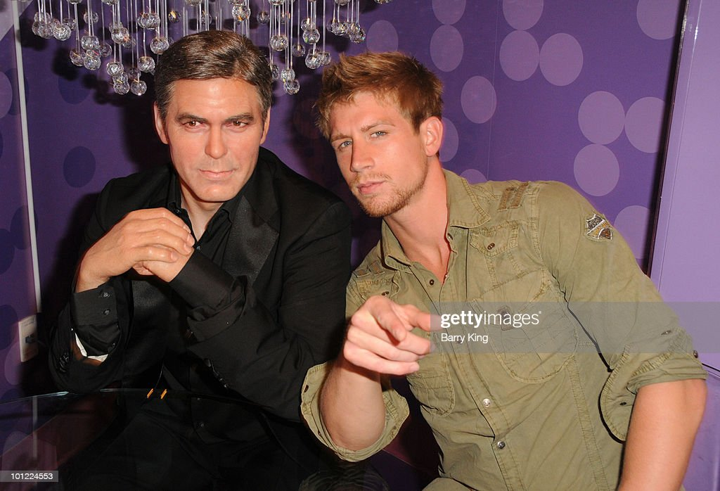 Actor Ryan McIntyre with George Clooney figure at the Official Los Angeles Event Celebrating Harvey Milk Day at Madame Tussaud's Hollywood on May 22, 2010 in Hollywood, California.