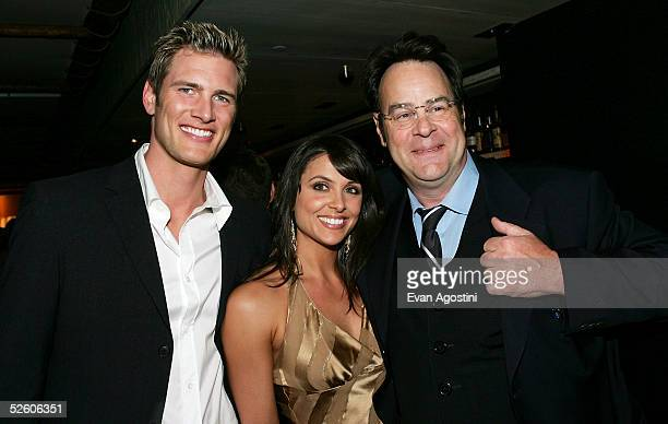 Actor Ryan McPartlin and wife Danielle pose with actor Dan Aykroyd at a party for the premiere the new TV series Living With Fran sponsored by...