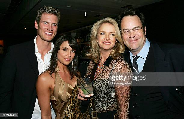 Actor Ryan McPartlin and wife Danielle pose with actor Dan Aykroyd and wife Donna Dixon at a party for the premiere the new TV series Living With...
