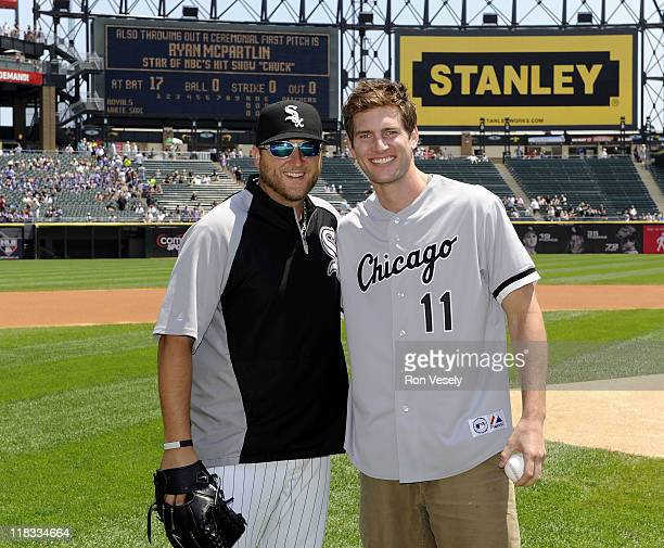 Actor Ryan McPartlin star of the television series Chuck poses with White Sox pitcher Mark Buehrle after throwing a ceremonial first pitch prior to...