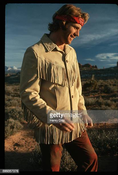 Actor Ryan O'Neal wears a red bandana around his head and a fringed leather jacket while on location for the motion picture Wild Rovers