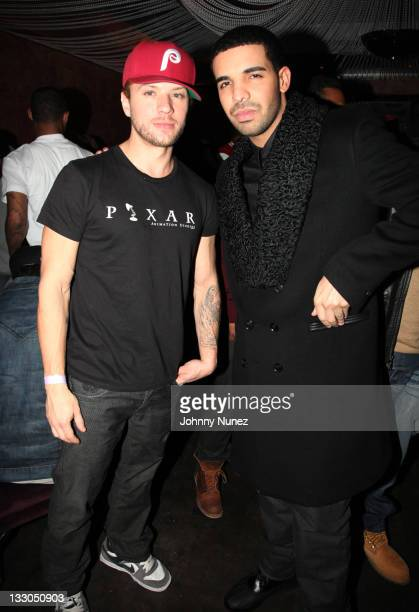 Actor Ryan Phillippe and rapper Drake attend Drake's album release party at Beauty Essex on November 15 2011 in New York City