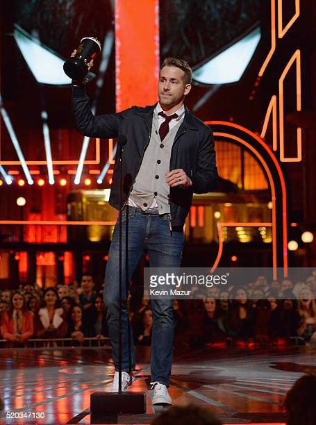Actor Ryan Reynolds accepts the Best Comedic Performance award for 'Deadpool' onstage during the 2016 MTV Movie Awards at Warner Bros Studios on...