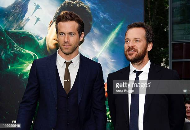 Actor Ryan Reynolds and actor Peter Sarsgaard attend the 'Green Lantern' Germany Premiere at CineStar on July 25 2011 in Berlin Germany
