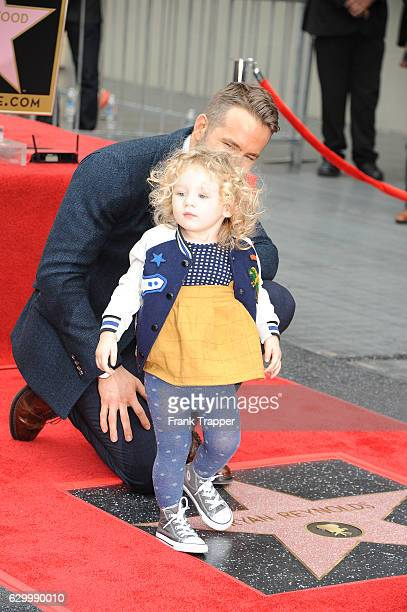 Actor Ryan Reynolds and daughter attend the ceremony that honored Ryan Reynolds with star on the Hollywood Walk of Fame on December 15 2016 in...