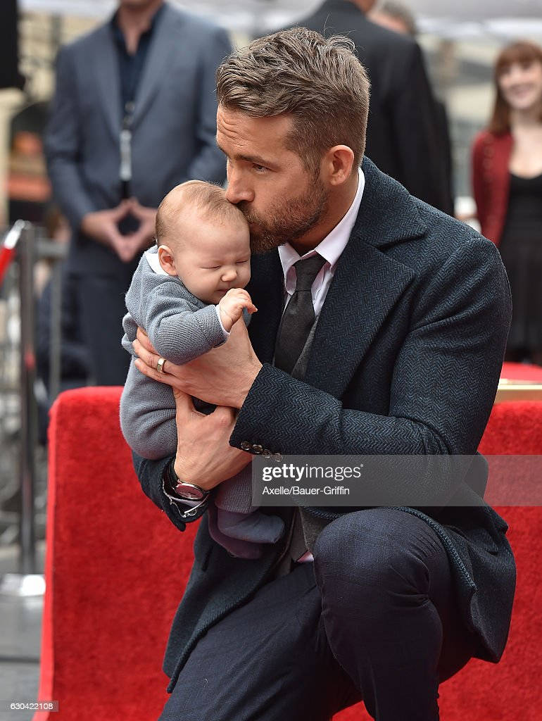 Actor Ryan Reynolds and daughter Ines Reynolds attend the ceremony honoring Ryan Reynolds with a Star on the Hollywood Walk of Fame on December 15, 2016 in Hollywood, California.