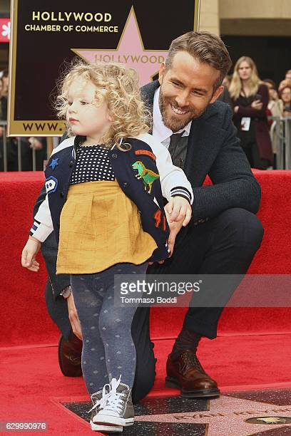 Actor Ryan Reynolds and daughter James Reynolds attend a ceremony honoring actor Ryan Reynolds with Star on the Hollywood Walk Of Fame on December 15...