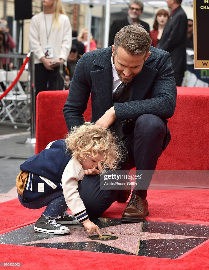 Actor Ryan Reynolds and daughter James Reynolds attend the ceremony honoring Ryan Reynolds with a Star on the Hollywood Walk of Fame on December 15, 2016 in Hollywood, California.