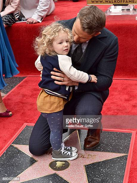 Actor Ryan Reynolds and daughter James Reynolds attend the ceremony honoring Ryan Reynolds with a Star on the Hollywood Walk of Fame on December 15...