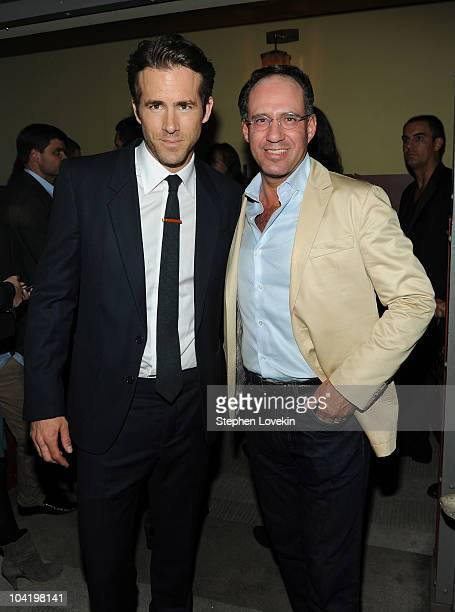 Actor Ryan Reynolds and founder of The Cinema Society Andrew Saffir attend the after party following a special screening of Buried hosted by The...