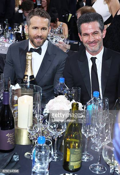 Actor Ryan Reynolds and producer Simon Kinberg attend the 22nd Annual Critics' Choice Awards presented by Landmark Vineyards at Barker Hangar on...