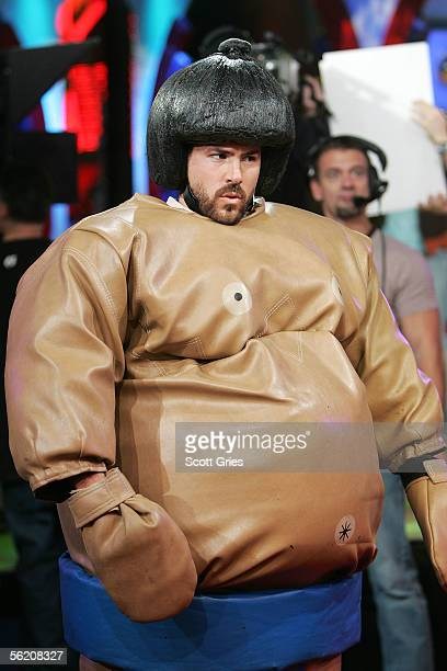 Actor Ryan Reynolds appears in a sumo wrestling suit onstage during MTV's Total Request Live at the MTV Times Square Studios on November 17 2005 in...