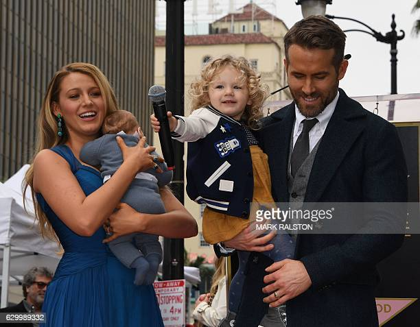 Actor Ryan Reynolds holds his daughter James as his wife Blake Lively holds their unnamed new baby during the Deadpool actors Hollywood Walk of Fame...