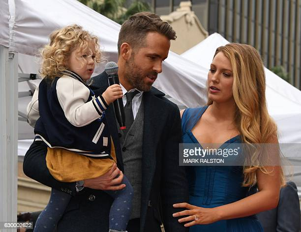 Actor Ryan Reynolds holds his daughter James as his wife Blake Lively looks on the Deadpool actors Hollywood Walk of Fame ceremony in Hollywood...