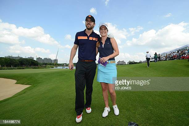 Actor Ryan Reynolds of the US and golfer Liebelei Lawrence of the US leave the 18th green after final day of the World Celebrity ProAm golf...