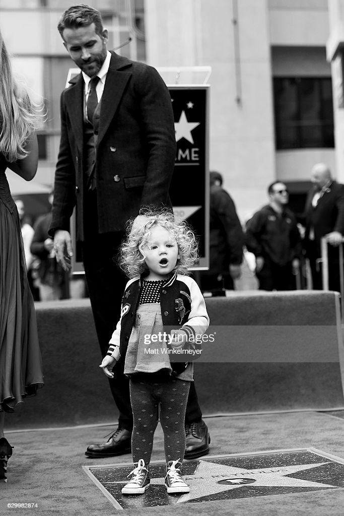 Actor Ryan Reynolds pose for a photo with his daughter James Reynolds as Ryan Reynolds is honored with star on the Hollywood Walk of Fame on December 15, 2016 in Hollywood, California.
