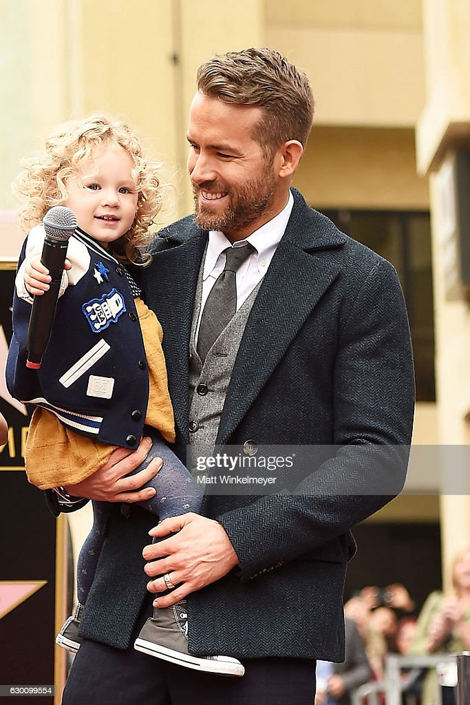 Actor Ryan Reynolds (R) poses for a photo with his daughter, James Reynolds during a ceremony honoring him with a star on the Hollywood Walk of Fame on December 15, 2016 in Hollywood, California.