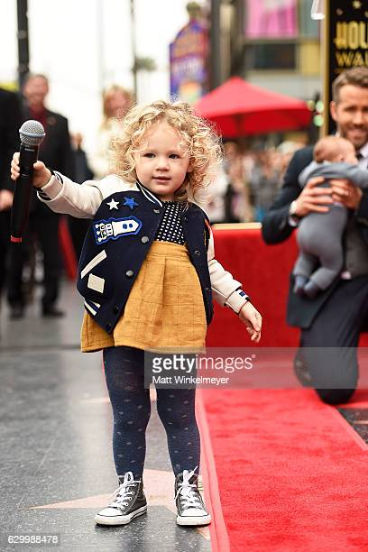 Actor Ryan Reynolds poses for a photo with his daughters during a ceremony honoring him with a star on the Hollywood Walk of Fames on December 15...