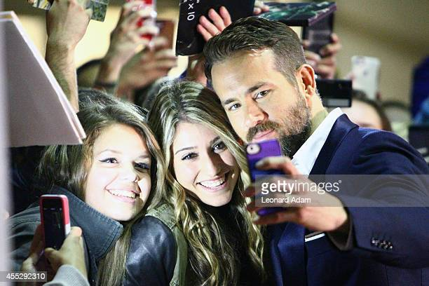 Actor Ryan Reynolds poses for a selfie as he attends The Voices premiere during the 2014 Toronto International Film Festival at Ryerson Theatre on...